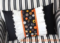 Buttons & ruffled pillow.  EASY & quick to add all these covered buttons.