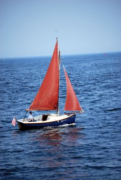 Red sail boat looks nice in a white frame