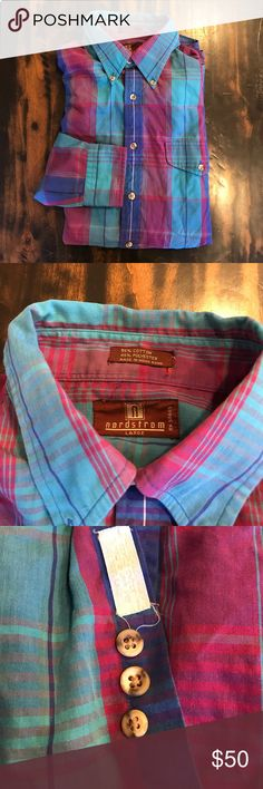 EUC Nordstrom Plaid Dress Shirt This dress shirt is in excellent used condition! My husband only wore it twice. The replacement buttons are still attached. There are no imperfections. This dress shirt features a bold mix of colors. It looks great with a solid or polka dot tie! Make an offer and add this vibrant piece to your closet! Nordstrom Shirts Dress Shirts