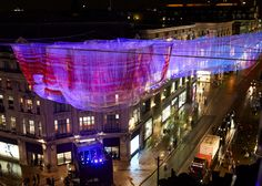 Janet Echelman has suspended a billowing woven sculpture based on data captured from the 2011 Japanese earthquake and tsunami above London's busy Oxford Circus