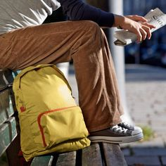ideal for your holidays !! this leightweight rucksack folds into its front pocket by Reisenthel