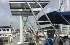 """On photo: fully accessorized his """"Tower In A Box"""" Sailing Arch from Atlantic Towers. Solar panels and an outboard motor stand are just a few of the accessories available."""