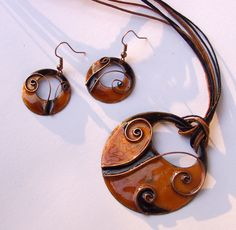 I created this serie inspired by shells, wood shavings, and geometric patterns appear on plants, like spiral forms on growing fern. But I gave them happy and sometimes candy-like colours. All my jewelery is handmade using copper and enamel. The pattern I form by hand from copper wire.  I used vitreous and opaque enamel on copper and fired it in an enamelling kiln at approximately 870 degrees, three or more times, layer by layer. Each of my enamelled piece are unique, they are all handmade so…