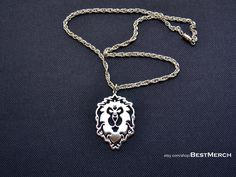 World of Warcraft WOW Logo Alliance Pendant. I love this! I'd like to see this logo and the Horde logo as earrings as well.