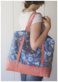 Slide a rolled up towel or two behind the adjustable long handles and head to the beach, butdon't limit this bag to summer! She'd also be a great grocery tote, yoga bag or weekender.There are pockets both outside and inside to keep your valuables in eas