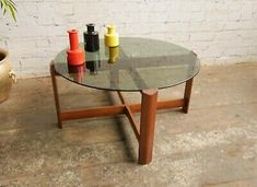 Maker: Myer. Teak wood construction. A very cool looking mid century coffee table - don't miss it! Smoke glass top.