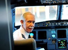 Miracle pilot Chesley (Sully) Sullenberger climbed back in his beloved captain's chair on Thursday, reuniting with First Officer Jeff Skiles for the first time since their extraordinary Hudson splashdown.
