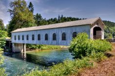 AN OLD FASHION COVERED BRIDGE IN OREGON.THERE ARE SEVERAL OLD COVERED BRIDGE'S IN KNOX COUNTY. THEY ARE A PART OF HISTORY.