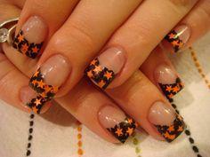 Black nails and orange stars. Love this!