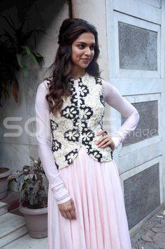 Deepika Padukone. Like the way her hair is styled...