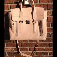 NWOT 3.1 Phillip Lim Pashli Satchel in Blush New, without tags.  Long strap is removable.  Gorgeous bag!  There are small scratches on the buckle of where it snaps closed (see pic). 3.1 Phillip Lim Bags Satchels