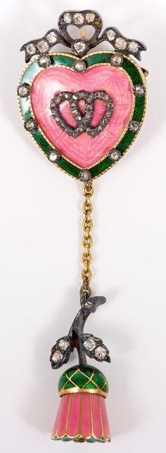 A Fine Victorian diamond and enamel sweetheart pendant locket brooch. The…