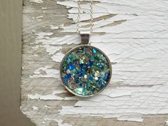 Glass glitter silver round pendant charm  by sewwhimsycreations