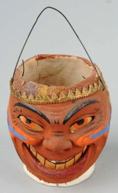 Comical Indian Gentleman Halloween Lantern. A very expressive and highly detailed lantern with inset paper mouth and eyes. Applied paper trims at crown. Intricate paint to face including crow's feet, applied facial decoration and eye brows. Retains original candle holder within.