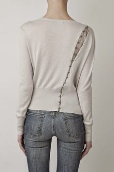Cool way to make a simple sweater more interesting. Add a chiffon inset, button loops and buttons.