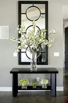 Entryway Table Decor Inspiration But WHITE- Outstanding Arrangement of Simple Stems in the Tall Glass Vase…The Small, insignificant ones underneath aren't very imaginative…Anything, or Nothing would have made a better statement to me… Foyer Decorating, Decorating Your Home, Decorating Ideas, Interior Decorating, Interior Ideas, Cheap Home Decor, Diy Home Decor, Interior Design Minimalist, Decoration Entree