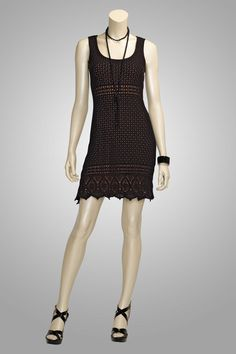 """Darling"" black pointelle knit sleeveless sweater dress with crochet trim."