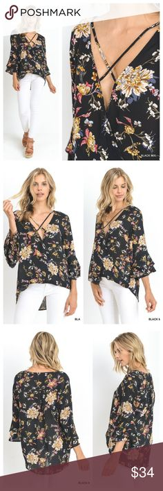 Black Criss-Cross Neck Bell Sleeve Top Top is a black floral with a criss-cross neck. Front of top crosses over and turns up at bottom, overall hi low. Sleeves are a cropped double bell. Fabric is semi-sheer, so you will want something underneath. EVIEcarche Tops