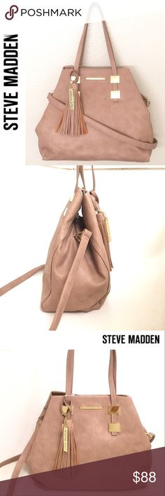 """Steve Madden Camel Colored Tote-Offers Welcome🌸 Brand new with tags. This sleek handbag by Steve Madden will accessorize your modern look while keeping your essentials organized. Crafted from quality faux leather, this Tote features fold over hinge clip closure; striking gold tone metal accents one roomy fully lined main compartment; 1  zip and 2 slip pockets on the interior; removable shoulder strap; removable tassel with logo; measures approximately 13""""W x 6""""D x 12""""H; handle drop- 8""""…"""