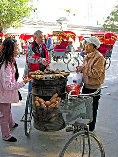 selling roasted sweet potatoes in Beijing. Very popular in the cold winter weather. Maybe a bit too hot in summer. But it is a must try street food when you are there. #beijing #streetfood