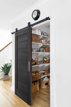 Pantry Barn Door Black Barn Door The pantry barn door was painted with Old Fashioned Milk Paint, color Pitch Black Kitchen Pantry Design, Kitchen Interior, Kitchen Storage, Kitchen Pantries, Farmhouse Interior, Farmhouse Style, Farmhouse Door, Kitchen Designs, Pantry Interior
