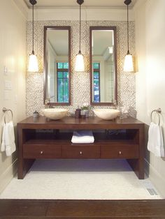 pendant light placement.  wooden sink stand.  not sure about the vessel sinks because of the splash factor.