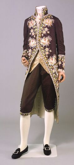 3-piece court suit, England, 1780-1785. Black silk brocade figured with purple circles and elaborate floral silk floss embroidery.