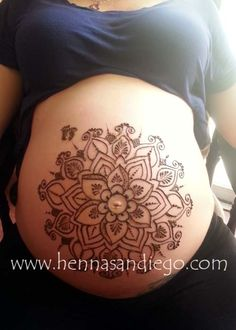 Pregnant belly henna design. Can't decide if I like this or not. But it is prettier than a lot of things I've seen a pregnant belly used for.
