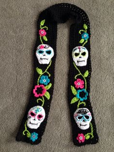 Day of the Dead scarf. Sorry, no pattern. Just a simple double crochet scarf emb. Day of the Dead scarf. Sorry, no pattern. Just a simple double crochet scarf embellished with skull Crochet Scarves, Crochet Shawl, Crochet Clothes, Crochet Stitches, Free Crochet, Knit Crochet, Holiday Crochet, Halloween Crochet, Halloween Make