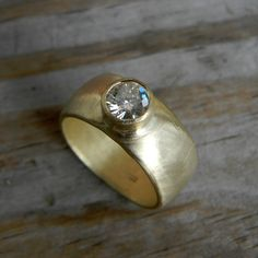 Moissanite Yellow Gold Engagement Ring, 14k Yellow Gold Banded Ring, Eco Friendly, Conflict Free by onegarnetgirl on Etsy https://www.etsy.com/listing/78108641/moissanite-yellow-gold-engagement-ring