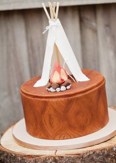 Woodgrain textured cake with teepee and campfire toppers