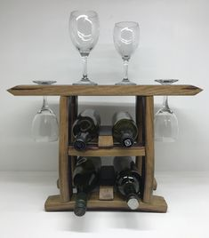 Countertop bottle and wine glass holder made from wine barrels Wine Barrels, Wine Glass Holder, Wine Racks, Storage Ideas, Countertops, Clever, Cabinet, Bottle, Furniture