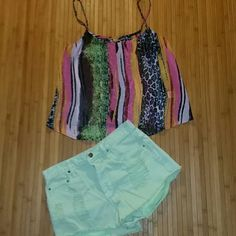 Forever 21 distressed mint green jean shorts 27 Forever 21 distressed mint green jean shorts 27.  Great condition. Distressed on front and back. Frayed legs. Green pockets hang out. Super cute. Bundle and Save! Please lmk if you have any questions. Reasonable Offers accepted. Thank you for shopping my closet. :) Forever 21 Shorts Jean Shorts