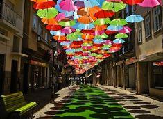 umbrella street agueda portugal | Floating-Umbrellas-Line-The-Streets-of-Agueda-Portugal-1.jpg