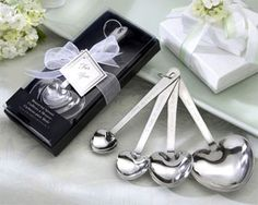 """One of our more popular favors, the """"Love Beyond Measure"""" Heart Measuring Spoons are a consistent hit with wedding guests; a quality Kate Aspen original."""