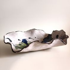 Particular raku centrepiece. Handmade by Ars Ceramicandi made of raku terrain, glaze and glass grain.