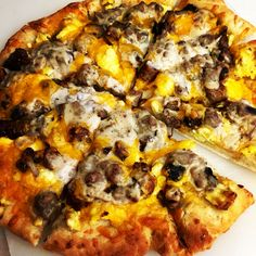 Breakfast pizza. Standard pizza dough, add olive oil. Place scrambled eggs, cooked sausage, cheese, and sausage gravy (made from sausage drippings) on top. Bake about 15 min at 425. Mm mmmm good.