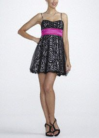 This glitter zebra print prom dress is perfect forany true fashionista not afriad to stand out from the crowd!  Spaghetti strap charmuese dress features eye-catching glitter zebra print.  Empire waist band creates a flattering silhouette.  Fully lined. Imported polyester. Spot clean.