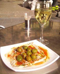 Olives and sardines in tomato sauce and rich Spanish olive oil~ street side opposite La Sagrada Familia in Barcelona, Spain 2011