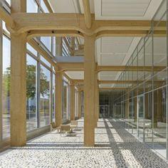 Construcciones de madera en altura. Edificio de madera para oficinas en Suiza http://ventacasasdemadera.com/blog/   #madrid #casademadera #madera #casaspersonalizadas