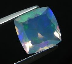 1.68ct.Excellent Rainbow color play Cushion Cut Natural  Ethiopian White Opal