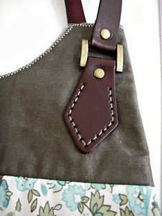 At home with Mrs H: Tutorials- how to attach leather handles. Good photos here.