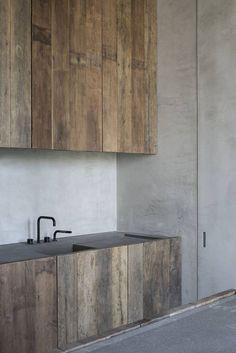 Old materials yet sleek kitchen. Kitchen - C Penthouse in Antwerp Belgium by Vincent Van Duysen Contemporary Kitchen Design, Interior Design Kitchen, Modern Interior Design, Interior Architecture, Kitchen Designs, Kitchen Taps, New Kitchen, Kitchen Cabinets, Island Kitchen