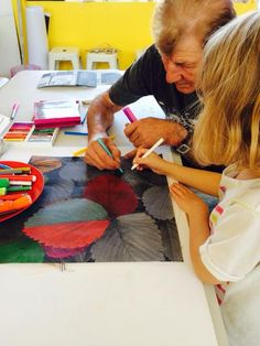 Children and families creating art at Pom Pom.