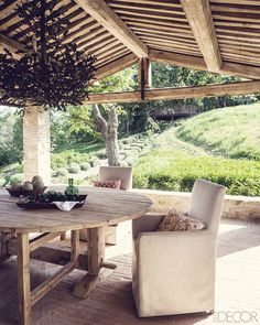 Covered, outdoor dining in Umbria, Italy. Love the wood beams. Home of designer Eric Egan.