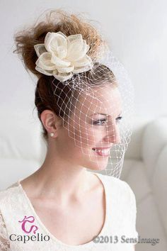 Flower & bridcage veil wedding hair accessory for the bride