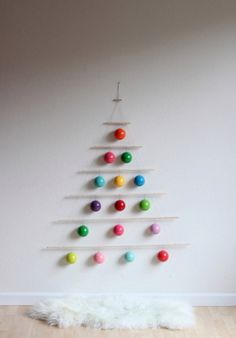 Instead of cutting down a tree or buying plastic: make a dowel tree. Idea - wrap lights around the dowels?