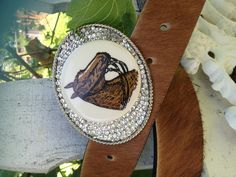 Vintage horse show ribbon button centered onto a beautiful oval buckle surrounded in Swarovski crystals and paired with a genuine cowhide belt from Argentina Judy's Buckles Www.judybuckles.com $240