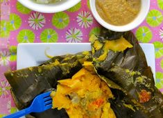 Latin American Recipes: Traditional Favorites (PHOTOS) - Columbian Tamales de Pipian - made with corn based dough and filled with meats, cheeses or vegetables and steamed in a banana leaf.