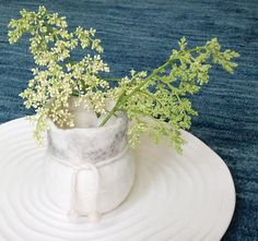 Small felted vase in white and gray. 100% wool fiber. Includes